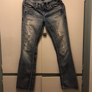 Size 28 Silver distressed jeans.